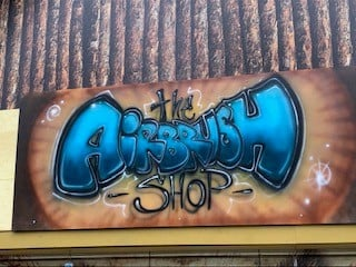 Sign for the airbrush shop store at six flags