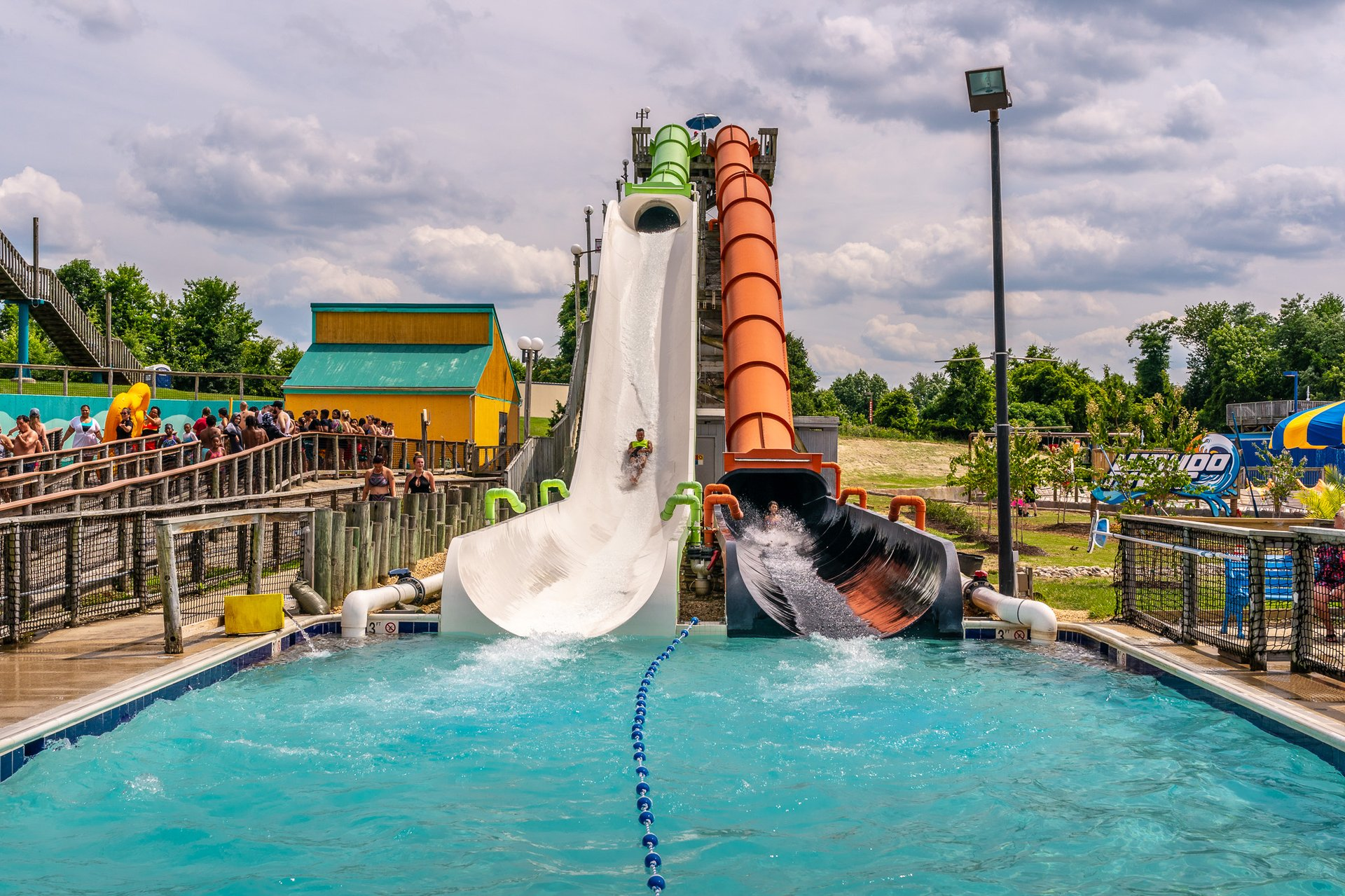 Shark Attack riders splashing into pool