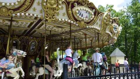 Guests riding the Grand Carousel at The Great Escape