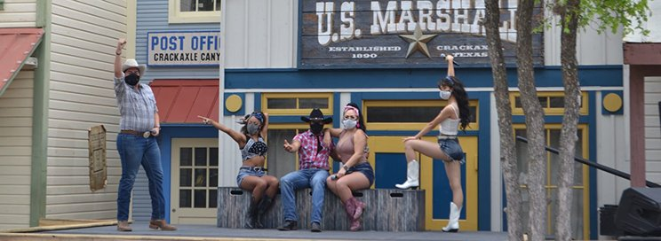 performers at Six Flags Fiesta Texas wearing western clothes