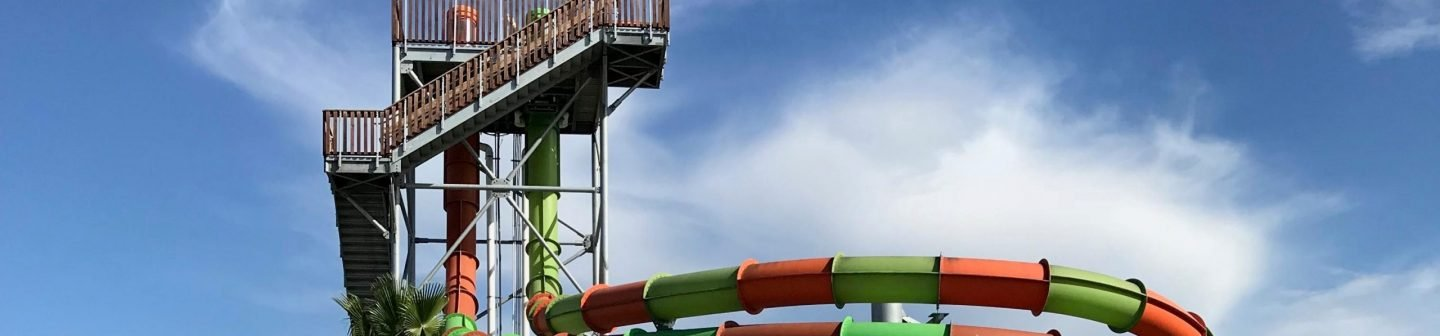 view of break point plunge against a blue sky at Hurricane Harbor