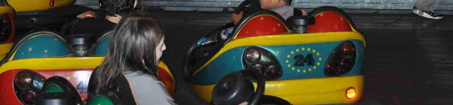People riding in bumper cars.