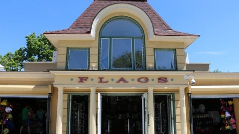 Flags retail store front with sign at six flags