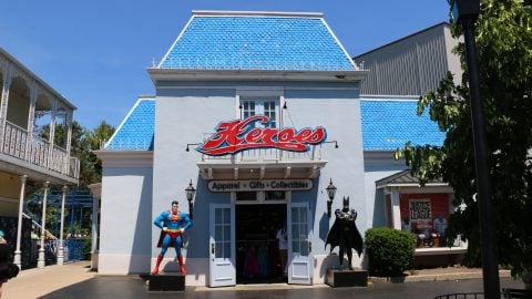 Batman and Superman statues in front of heroes retail store front and sign at six flags