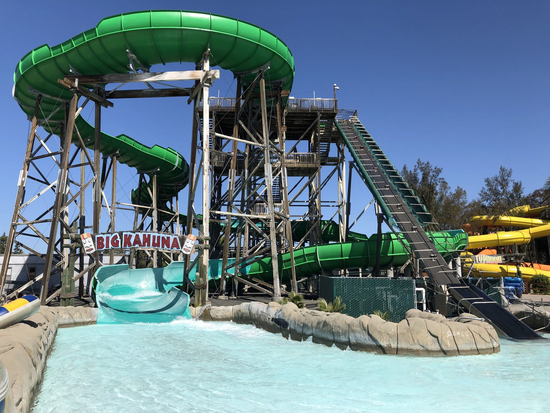 View of the splash down pool and sign for The Big Kahuna at Hurricane Harbor