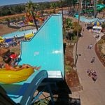 a guest about to take the plunge on Honolulu Halfpipe at Hurricane Harbor