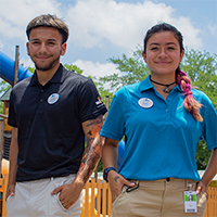 employees smiling and posing at six flags