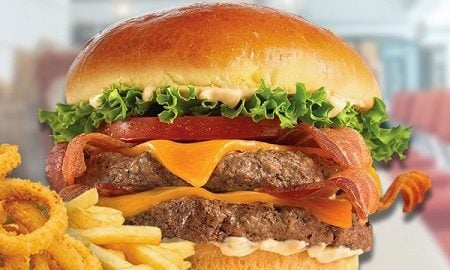 Double cheeseburger with bacon, tomato, and lettuce