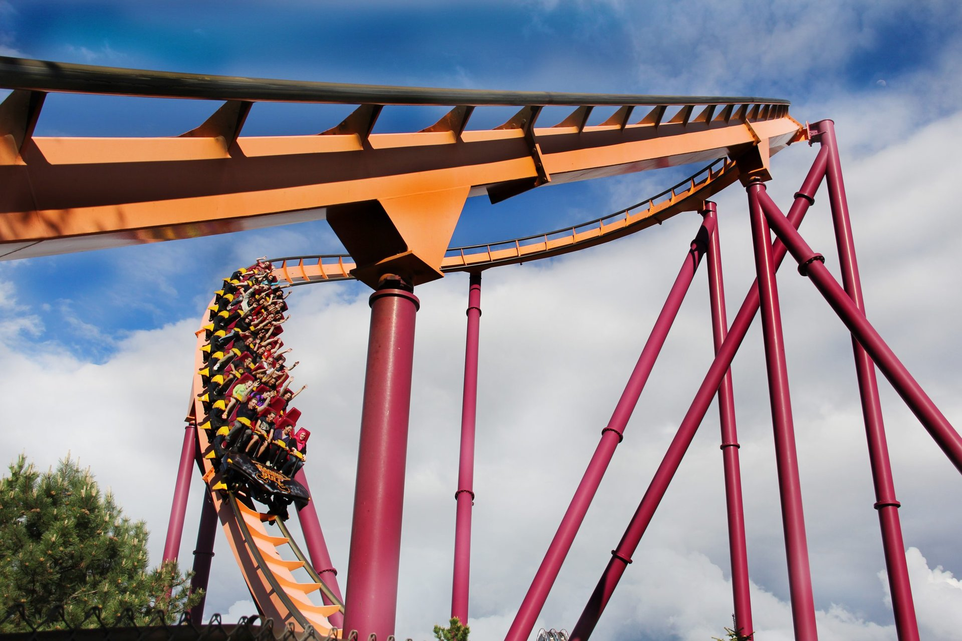raging bull with riders coming out of a turn at Six Flags