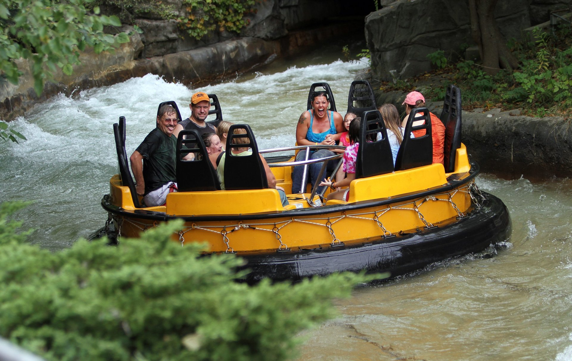 Riders soaked on Roaring Rapids coming out of tunnel at Six Flags