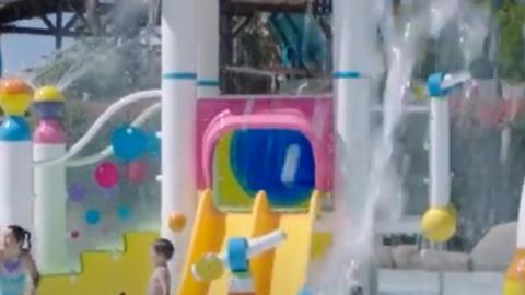 Kids playing in splashing, shooting water at Hurricane Harbor