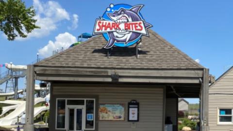 Shark bites sign at hurricane harbor
