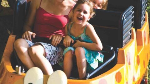Mother and daughter laughing on Marche Du Mille Pattes at La Ronde