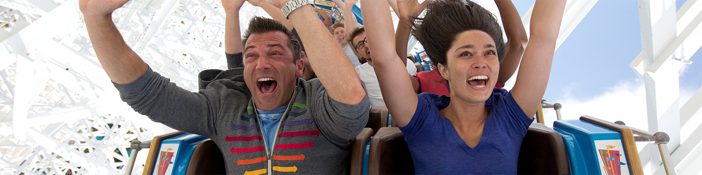 Guests screaming with their hands in the air while riding Twisted Colossus at Six Flags