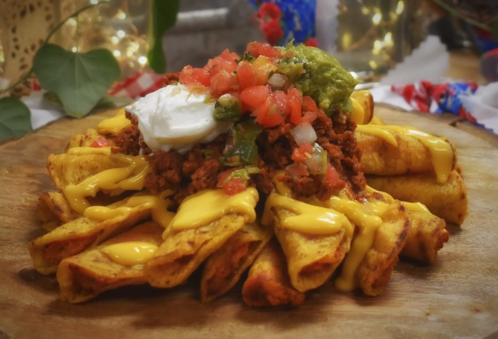 nachos topped with sour cream, pico de gallo, and guacamole