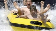 Guests screaming and splashing on Typhoon Twister at Six Flags