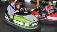 Guests riding bumper cars at Six Flags
