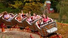 Guests riding Frankie's Mine Train at Six Flags
