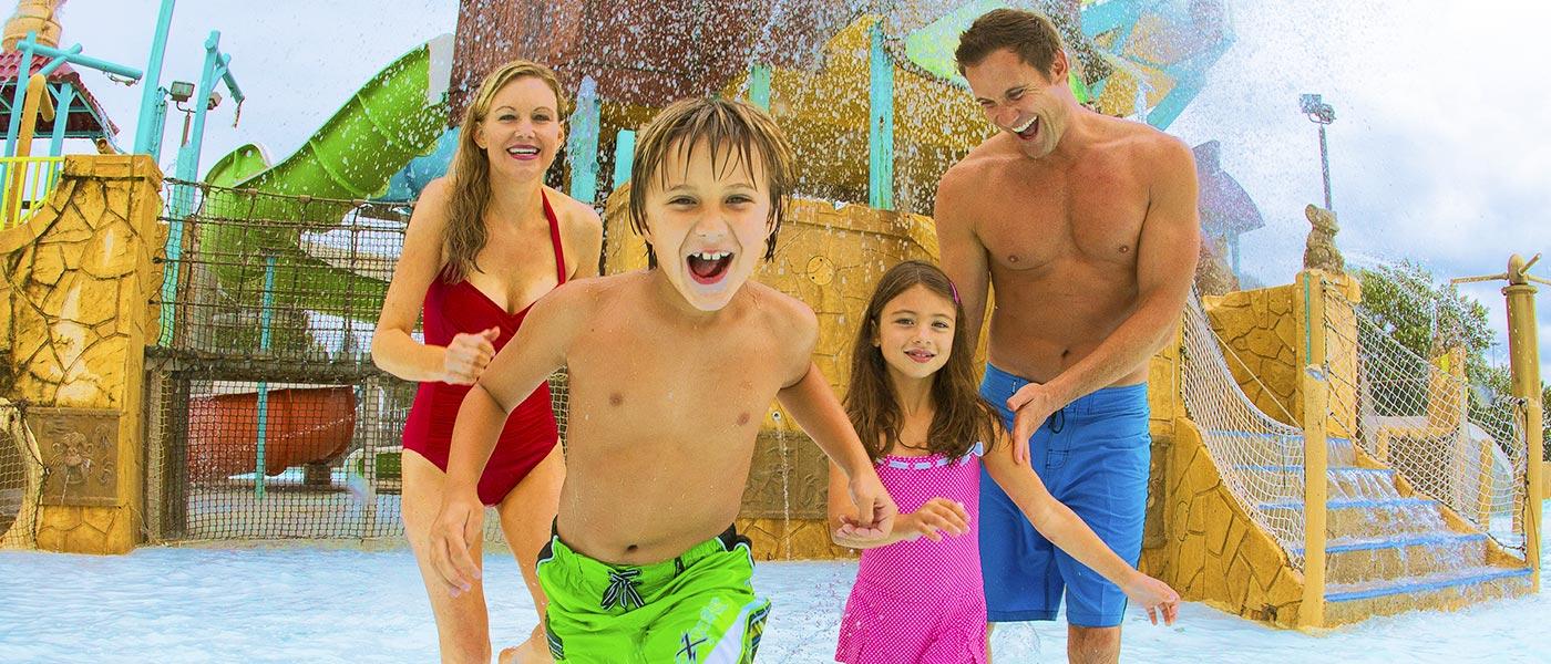 kids splashing at a play area at hurricane harbor