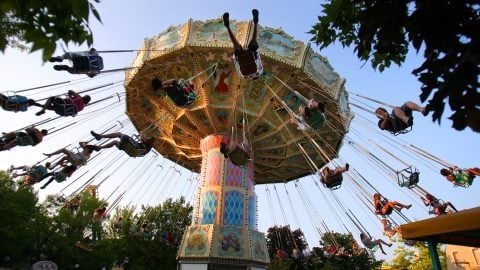 Whirligig with joyful riders at Six flags